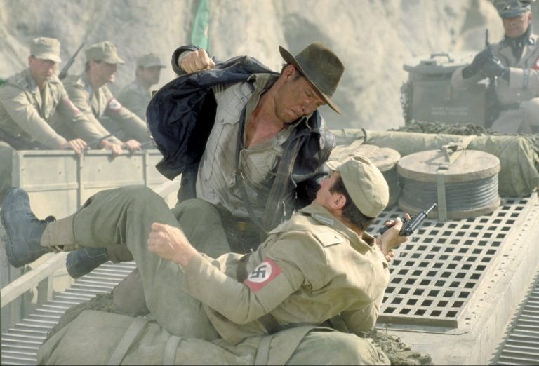 Indy punches a nazi.